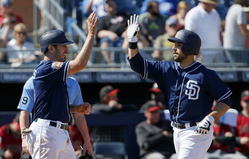 The Padres' Austin Hedges, right, celebrates his two-run home run against the Arizona Diamondbacks with Adam Rosales, left, during the second inning of a spring training baseball game Tuesday, March 8, 2016, in Peoria, Ariz.