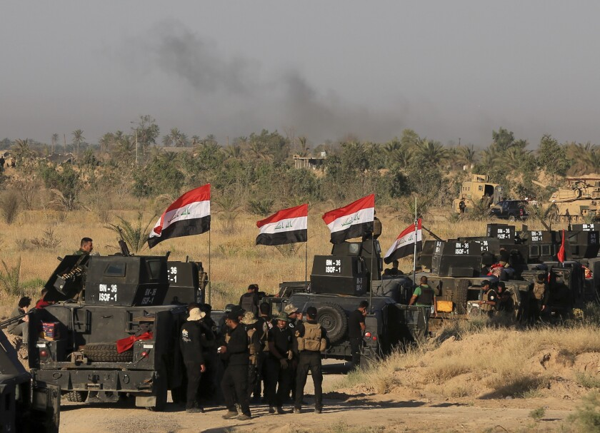 Smoke billows on the horizon as Iraqi military forces prepare for an offensive to retake Fallouja from Islamic State militants in Iraq on May 30, 2016.