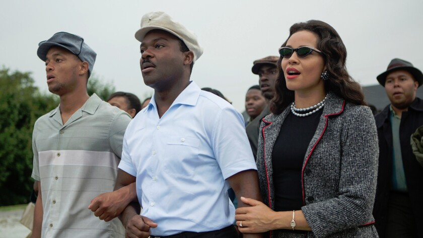 "David Oyelowo, center, as Martin Luther King, Jr. and Carmen Ejogo, right, as Coretta Scott King in ""Selma."""
