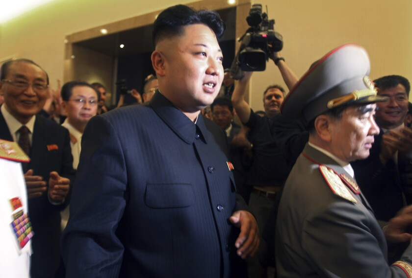 North Korean leader Kim Jong Un, center, is followed by his uncle Jang Song Thaek, second from left, as he tours a museum last summer in Pyongyang, the capital.
