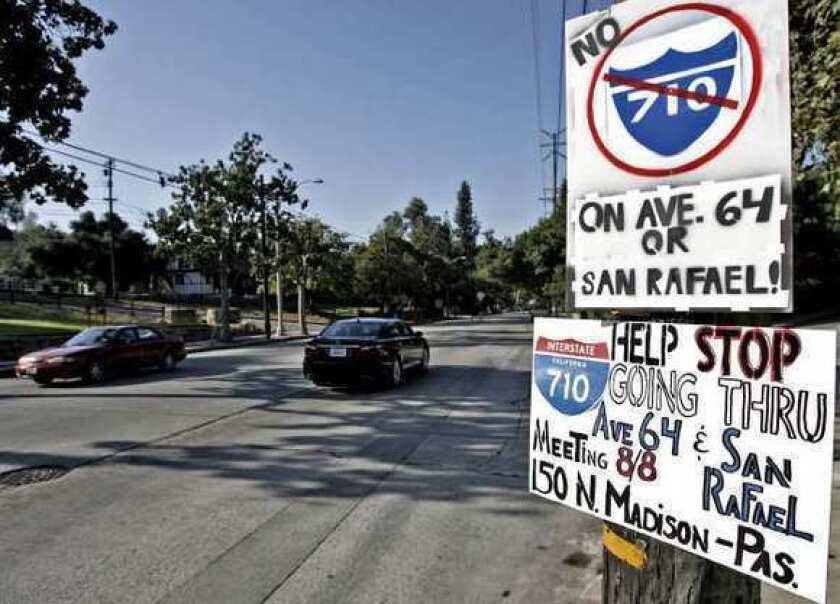 Signs opposing the 710 Freeway being built on Ave. 64 were placed at the corner of Church St. and Ave. 64 last summer in Pasadena.