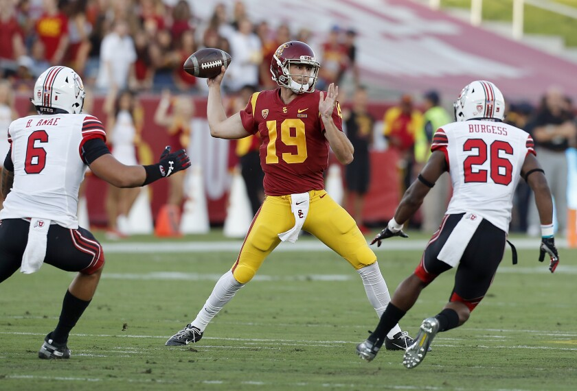 USC quarterback Matt Fink throws downfield against Utah in the first quarter at the Coliseum on Friday.
