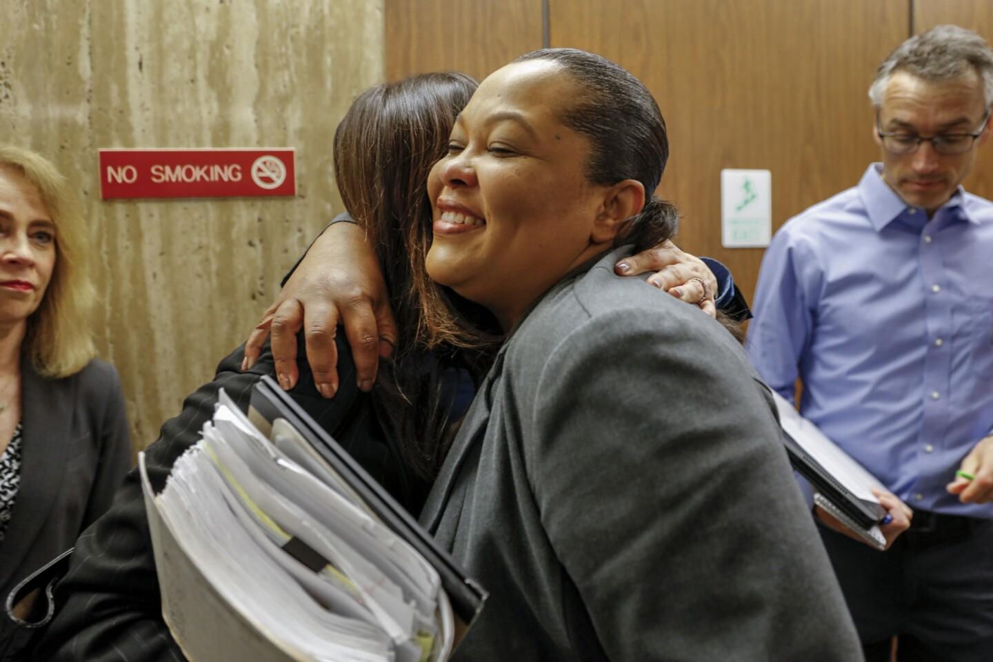 Samara Herard, right, hugs Deputy Dist. Atty. Beth Silverman before speaking to the media about the guilty verdict for Lonnie Franklin Jr. Herard's sister, Princess Berthomieux, 15, was found strangled and beaten March 19, 2002, in an Inglewood alley.