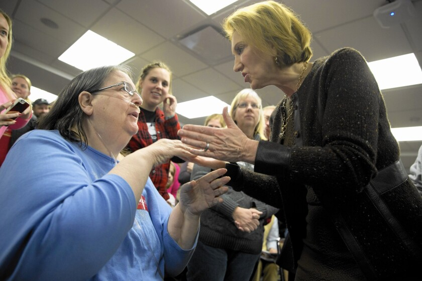 Carly Fiorina greets a supporter during a campaign event at Iowa State University on Saturday.