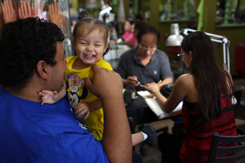 Jesus Puga laughs with his daughter Anna-Marie Puga