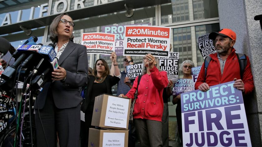 Stanford law professor Michele Dauber speaks at a rally outside the San Francisco offices of the California Commission on Judicial Performance calling for the removal of Judge Aaron Persky from the bench.