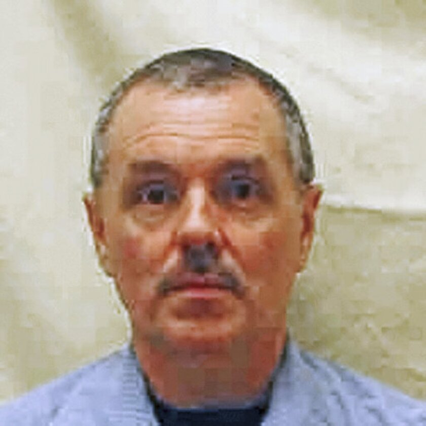 """FILE - This undated file photo provided by the Ohio Department of Rehabilitation and Correction shows Donald Harvey, a serial killer who became known as the """"Angel of Death."""" An Ohio inmate has been handed a life sentence after pleading guilty to the fatal 2017 prison beating of Harvey. James Elliott, who had been serving time for a series of burglaries, admitted in court Tuesday, Sept. 24, 2019, that he fatally beat Harvey at the state prison in Toledo. (Ohio Department of Rehabilitation and Correction via AP, File)"""