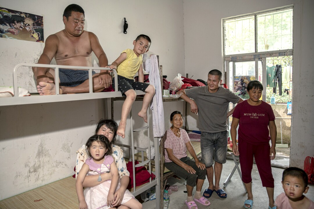 The Huang family, displaced from their village because of the floods.