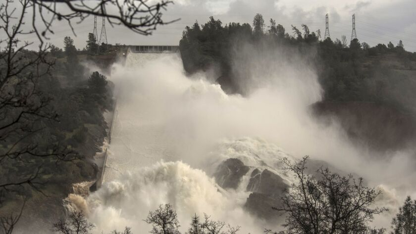 Water rushes down the damaged spillway at Lake Oroville in this Feb. 10, 2017, photo. A new study predicts that California will experience more swings between very dry and very wet years.