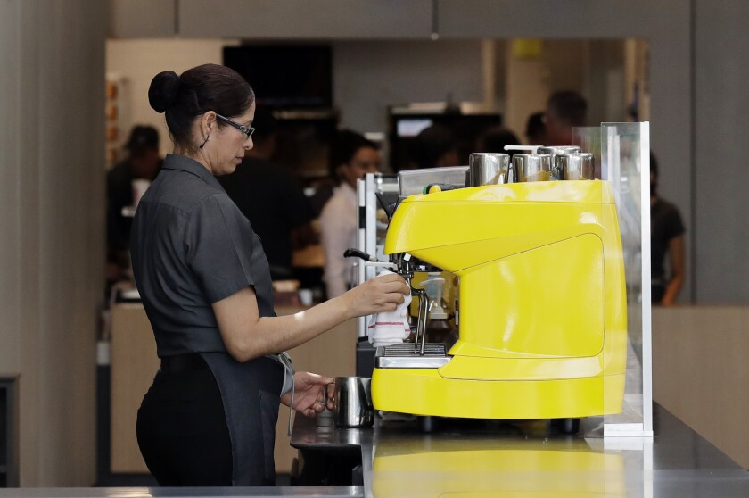 In this Aug. 8, 2018, photo an employee works at a McDonald's restaurant in Chicago. The Trump administration has issued a rule that will make overtime pay available to 1.3 million additional workers, though the proposal replaces a more generous one advanced by former President Barack Obama. The Labor Department said Tuesday, Sept. 24, 20119, that it is raising the salary level that companies will have to pay to exempt workers from overtime to $35,308 a year, up from $23,660. (AP Photo/Nam Y. Huh, File)