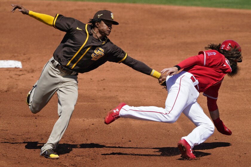 Padres second baseman CJ Abrams tags out Los Angeles Angels' runner Brandon Marsh.