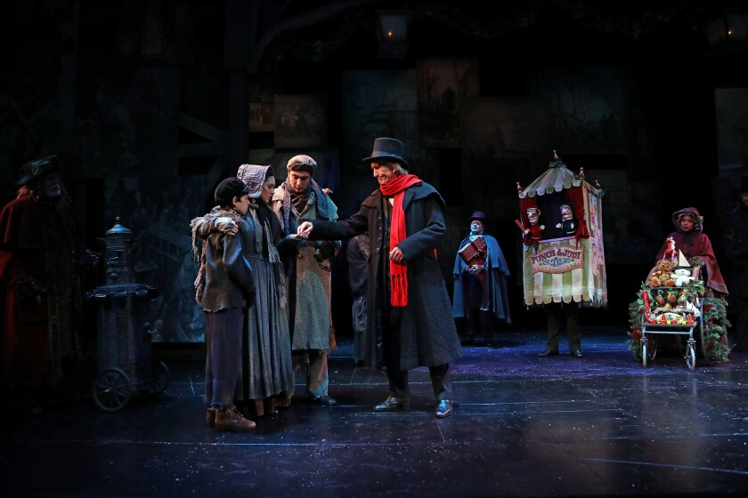 """The theater announced the generous gift at Saturday's performance of """"A Christmas Carol"""" starring Hal Landon Jr., center."""