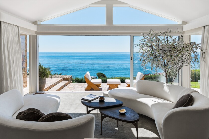 The three-acre spread above Paradise Cove includes a main house, guesthouse, guardhouse and a funicular that descends to 256 feet of beach frontage.