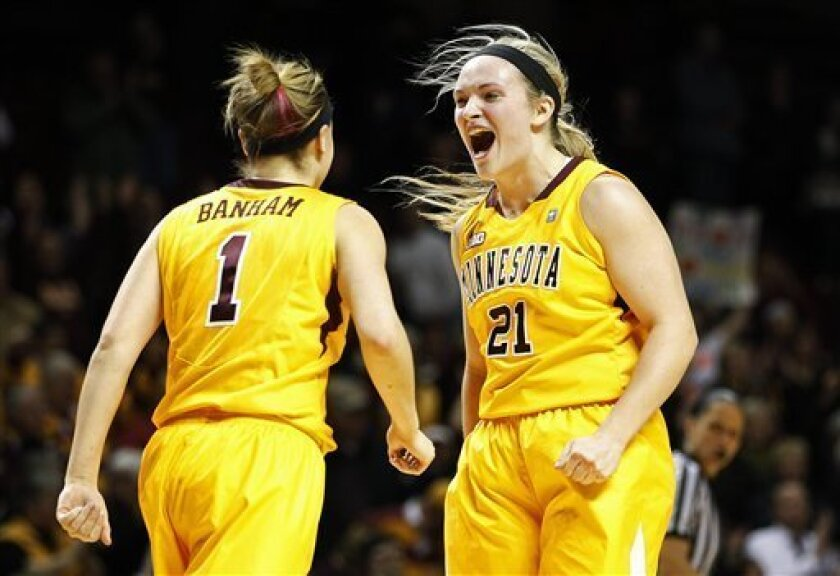 Minnesota guards Sari Noga (21) and Rachel Banham celebrate their 89-81 win against Penn State in an NCAA college basketball game, Thursday, Feb. 28, 2013, in Minneapolis. (AP Photo/Stacy Bengs)