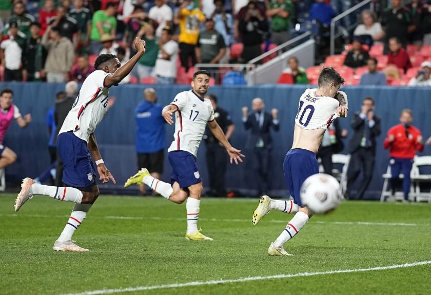 Christian Pulisic (10) celebrates scoring on a penalty kick