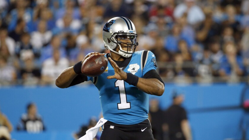 Panthers quarterback Cam Newton set up to pass against the Tampa Bay Buccaneers during a game on Sept. 12, 2019.