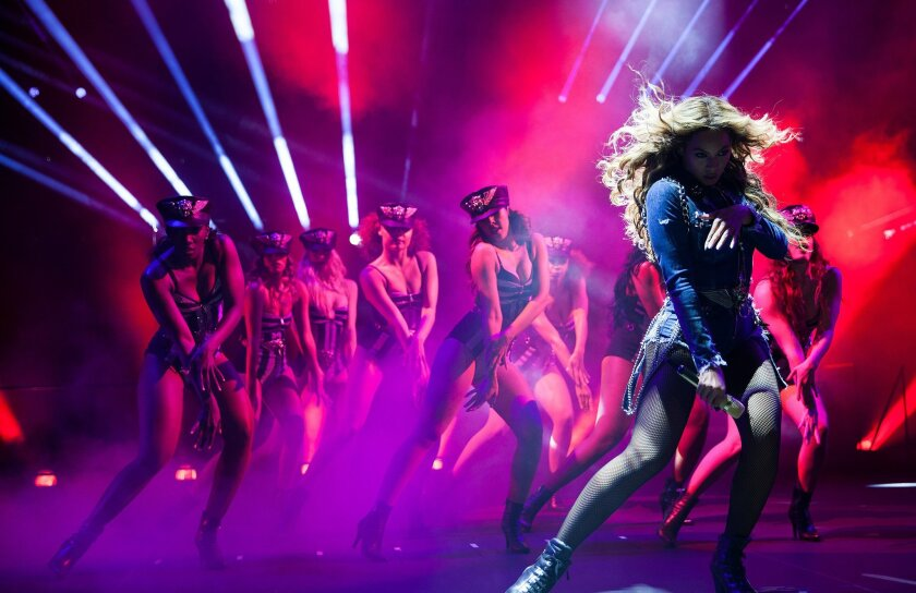 """AP10ThingsToSee - Beyonce performs during the """"On The Run"""" tour at the Georgia Dome on Tuesday, July 15, 2014, in Atlanta. (Photo by Rob Hoffman/Invision for Parkwood Entertainment/AP Images)"""