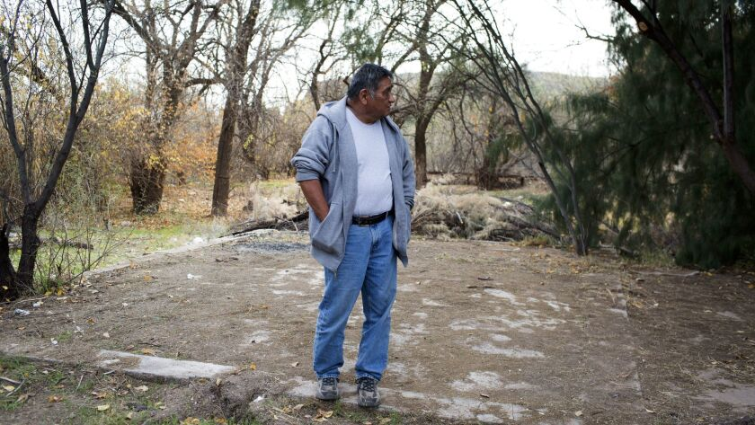 Mike Stevens stands on the foundation of the home his late wife, Lizette Stephens, lived in as a girl on the San Carlos Apache Reservation.