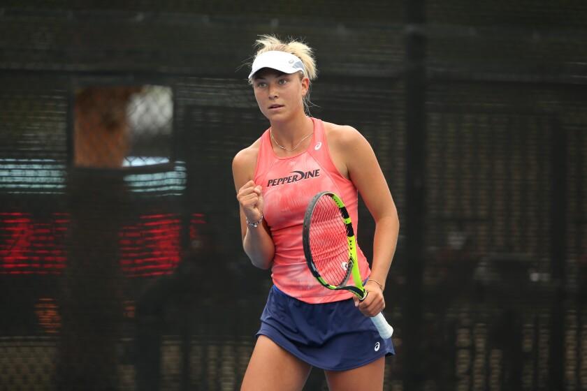 Pepperdine tennis player Ashley Lahey celebrates during a match.