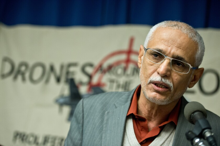 Yemeni engineer Faisal bin Ali Jaber, whose brother-in-law and nephew were killed in a 2012 drone strike, speaks at a news conference in November 2013 in Washington.