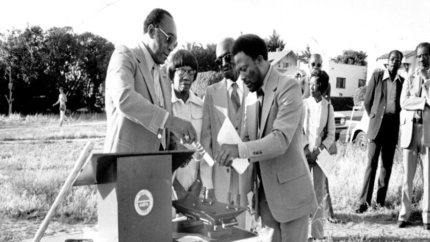 Groundbreaking of the SOFA Community Center at 7513 Cuvier St., circa 1976. Pictured are presiding elder of AME district (name unknown), members of Prince Chapel AME Eveline and Balco Allen and Reverend Charles Brooks.