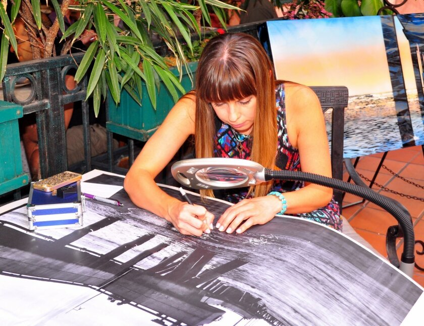 Nichole McDaniel works on her next 'etching' project.