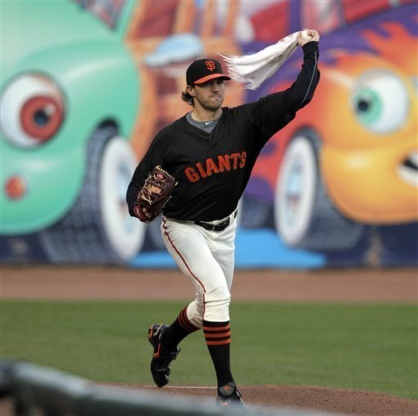 San Francisco Giants' Barry Zito warms up with a towel during a baseball workout Wednesday, Oct. 6, 2010, in San Francisco. The Giants will face the Atlanta Braves in Game 1 of a National League Division Series on Thursday. (AP Photo/Ben Margot)