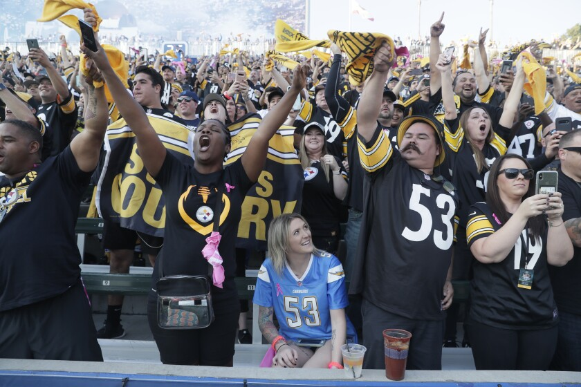 Chargers fan Kat Daly sits among the throngs of Steelers fans who attended Sunday's game at Dignity Health Sports Park.