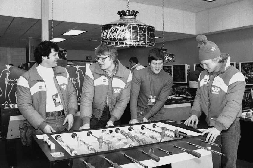 "FILE - In this Feb. 10, 1980, file photo, U.S. Olympic ice hockey players, from left, Michael Eruzione, Phil Verchota, John Harrington and Bob Suter play foosball in the game room of the Olympic village in Lake Placid, N.Y. Suter, a member of the ""Miracle On Ice"" team that won gold in 1980 and the father of Minnesota Wild star Ryan Suter, died on Tuesday, Sept. 9, 2014. He was 57. (AP Photo/File)"