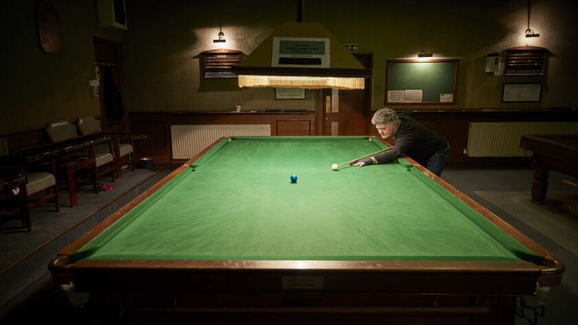 HORNCHURCH, ENGLAND - APRIL 13: Tony Gilligan, 76 practises snooker at the Hornchurch Conservative C