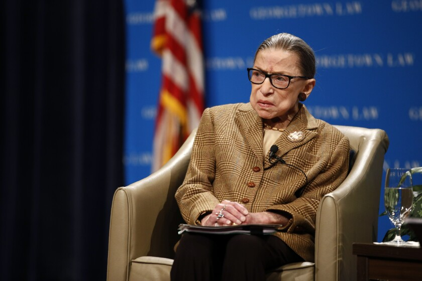 FILE - In this Feb. 10, 2020, file photo U.S. Supreme Court Associate Justice Ruth Bader Ginsburg speaks during a discussion on the 100th anniversary of the ratification of the 19th Amendment at Georgetown University Law Center in Washington. Ginsburg is perhaps the most forthcoming member of the Supreme Court when it comes to telling the public about her many health issues. But she waited more than four months to reveal that her cancer had returned and that she was undergoing chemotherapy. (AP Photo/Patrick Semansky, File)