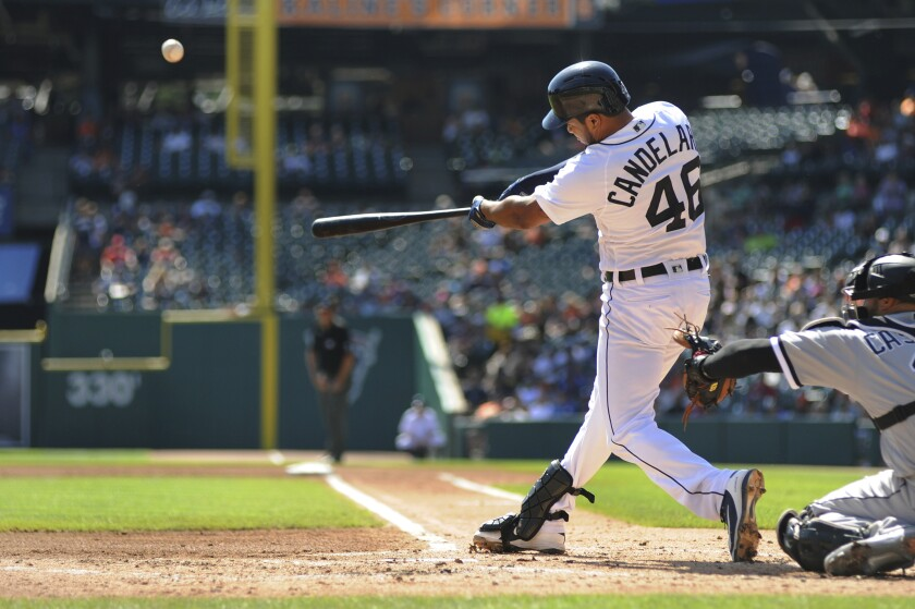 Detroit Tigers' Jeimer Candelario hits a two-run home run against the Chicago White Sox in the first inning of a baseball game, Sunday, Sept. 22, 2019, in Detroit. (AP Photo/Jose Juarez)