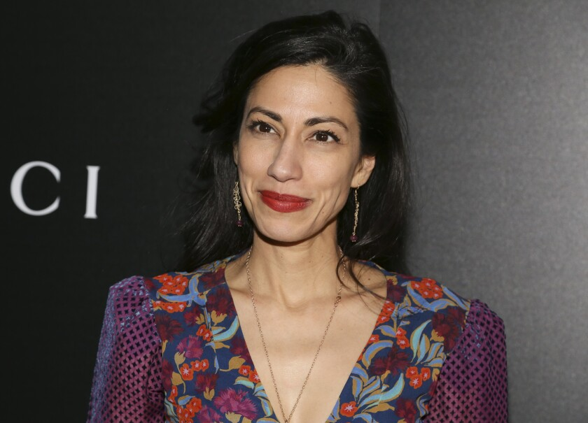 """FILE - Huma Abedin attends a screening of """"American Woman"""" on Dec. 12, 2019, in New York. Abedin has a memoir coming out this fall. The close aide to Hillary Clinton and estranged wife of disgraced former Rep. Anthony Weiner wrote """"Both/And: A Life in Many Worlds."""" Scribner told The Associated Press on Thursday that the book will be released Nov. 2. (Photo by Andy Kropa/Invision/AP, File)"""