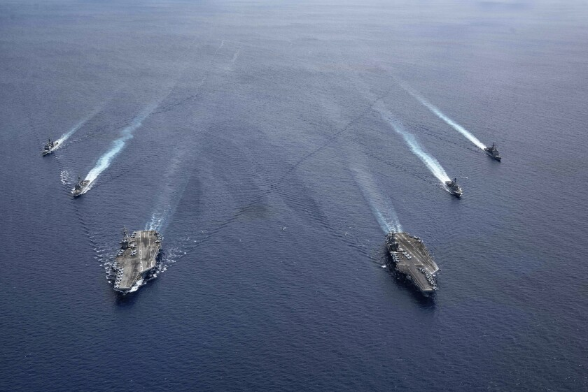 U.S. Navy cruisers steam in formation in the South China Sea.