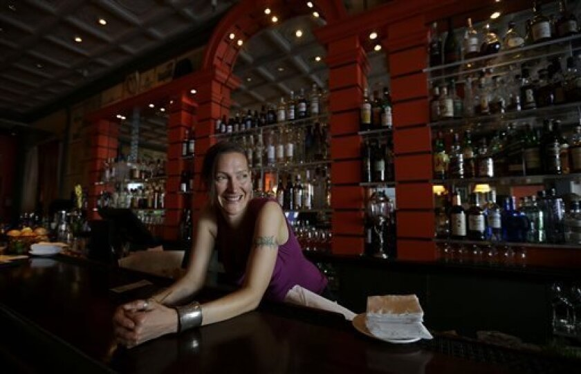 Bartender Valen West smiles while speaking to reporter at Zare at Fly Trap in San Francisco, Wednesday, April 3, 2013. Across California, 2 a.m. is the witching hour for bartenders to issue the last call for drinks. But a proposed state law would give nightlife loving cities the option of allowing
