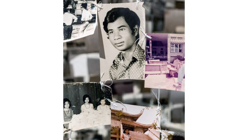 "Dinh Q. Lê collected photographs left behind by people fleeing Vietnam and created two haunting collages for the ""Viet Stories"" exhibition."