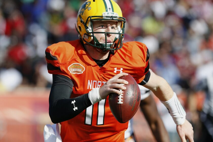 FILE - In this Jan. 30, 2016, file photo, North squad quarterback Carson Wentz of North Dakota State (11) scrambles with the ball during the Senior Bowl NCAA college football game at Ladd–Peebles Stadium in Mobile, Ala. North Dakota State football coaches enjoyed some free advertising on the recrui