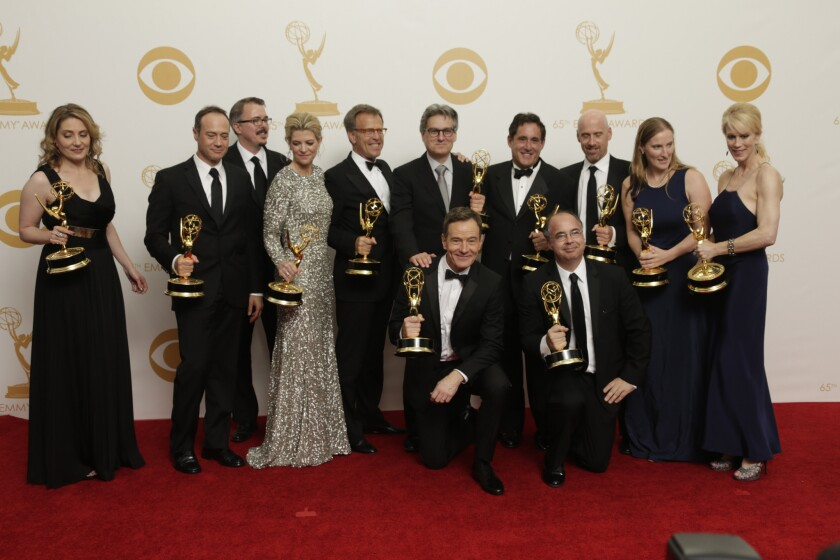 """The """"Breaking Bad"""" crew, winner of the drama series Emmy at the 65th Annual Primetime Emmy Awards, pose in the press room."""