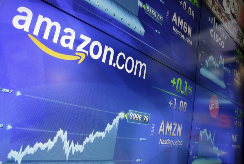 FILE - In this Tuesday, May 30, 2017, file photo, the Amazon logo is displayed at the Nasdaq Market Site, in New York's Times Square. Germany's finance minister on Wednesday welcomed an agreement requiring large companies in the European Union to reveal how much tax they paid in which country. The deal was struck late Tuesday between representatives of the EU's 27 member states and the European Parliament. (AP Photo/Richard Drew, File)