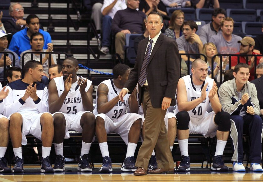 USD Head Coach Bill Grier paces in front of his bench near the end of his team's 74-68 victory over BYU.