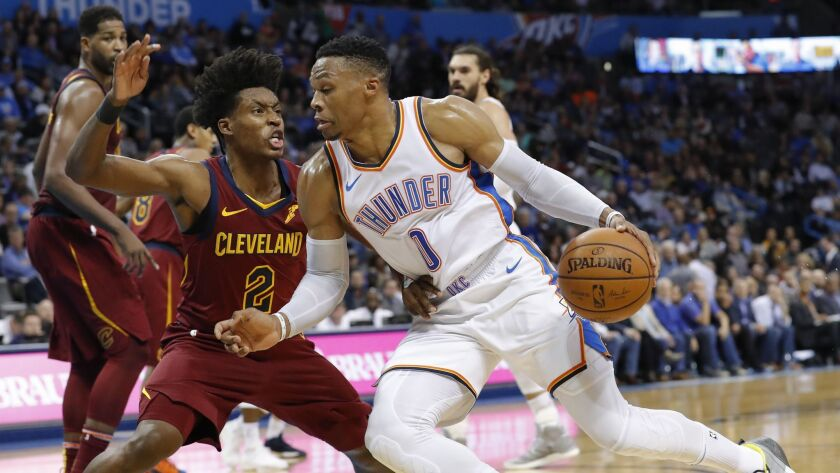 Oklahoma City Thunder guard Russell Westbrook (0) drives to the basket against Cleveland Cavaliers guard Collin Sexton (2) during the second half.