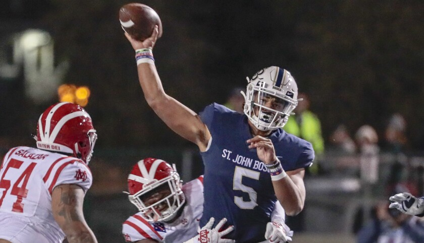 St. John Bosco aquarterback DJ Uigaleilei unloads a pass while pressured by Mater Dei on Nov. 30, 2019, during the Southern Section Divsion 1 championship game at Cerritos College.