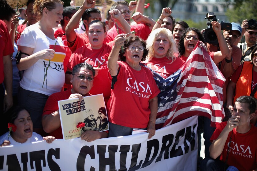 More than 300 demonstrators protest at the White House in August 2014 to demand President Obama halt deportations.