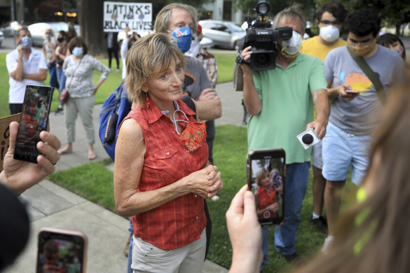 Healdsburg Mayor Leah Gold gets into a pointed exchange with protesters on June 11.