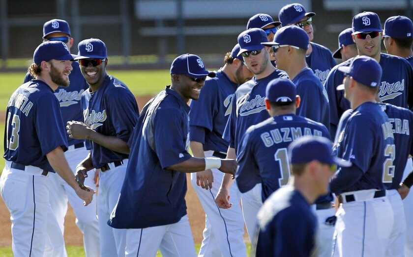 San Diego Padres Orlando Hudson jokes with teammates at spring training in Peoria.