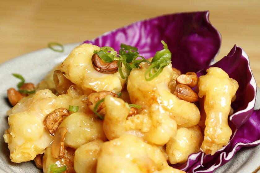 Honey Cashew Shrimp from Monkey King is tempura battered shimp tossed in a creamy honey glaze and garnished with roasted cashews.