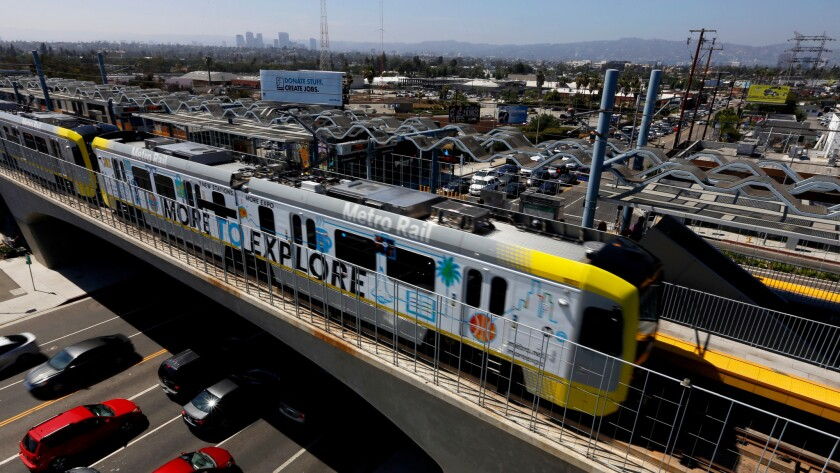 An Expo Line train departs the La Cienega/Jefferson Station on July 9. A new 30-story high-rise complex that has been proposed for construction near the station would reportedly offer upscale apartments, a supermarket, sit-down restaurants and open green space.