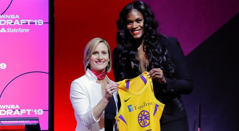 Baylor's Kalani Brown, right, poses for a photo with WNBA COO Christy Hedgpeth after being selected