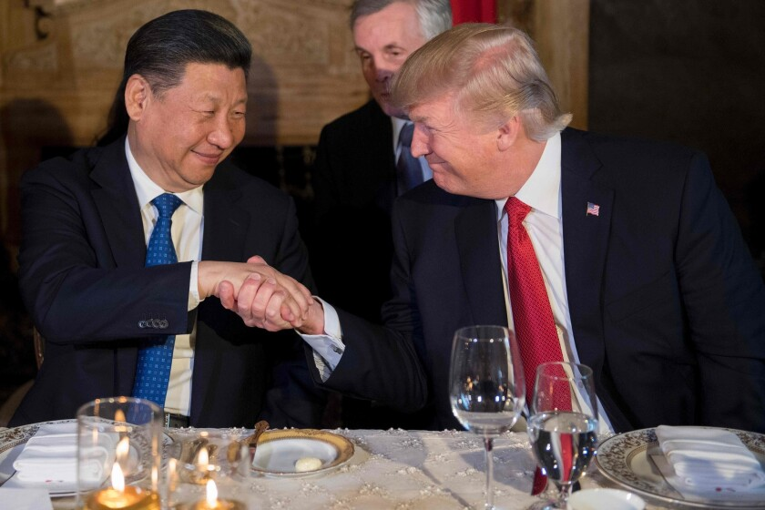President Trump and Chinese President Xi Jinping shake hands during dinner at the Mar-a-Lago estate in West Palm Beach, Fla., on April 6.