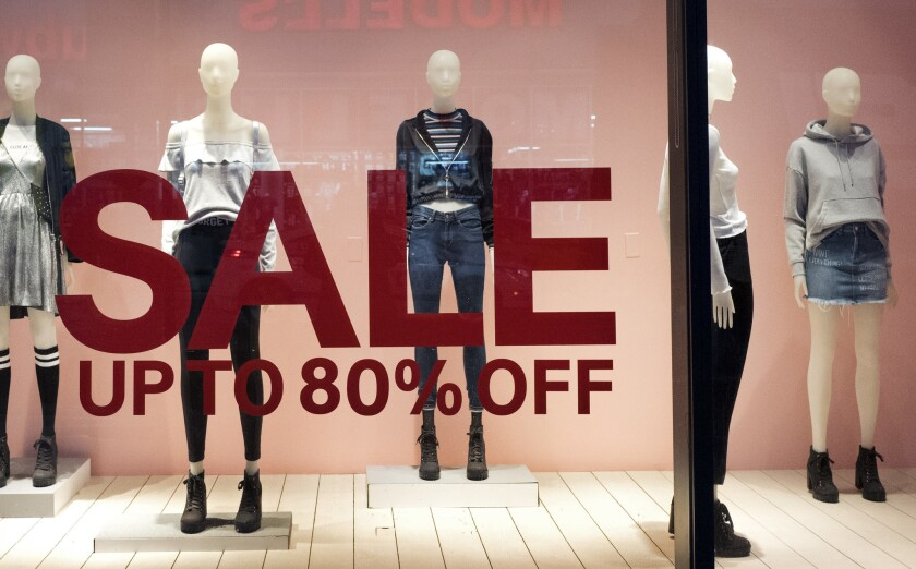 An H&M store window advertises a sale Wednesday in New York. On Friday, the Commerce Department releases U.S. retail sales data for December.